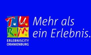 Logo T.U.R.M. ErlebnisCity Oranienburg mit Slogan Mehr als ein Erlebnis