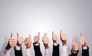 Human hands showing thumbs up