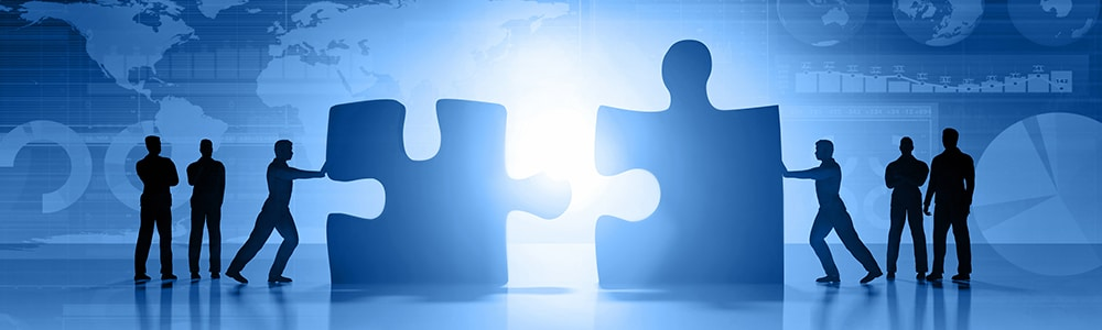Zwei große Puzzle-Teile werden zusammengeführt für die Darstellung der EDI Schnittstellen