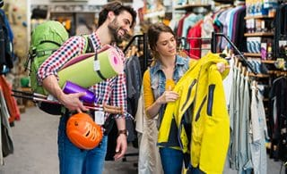 Man and woman buying sports goods